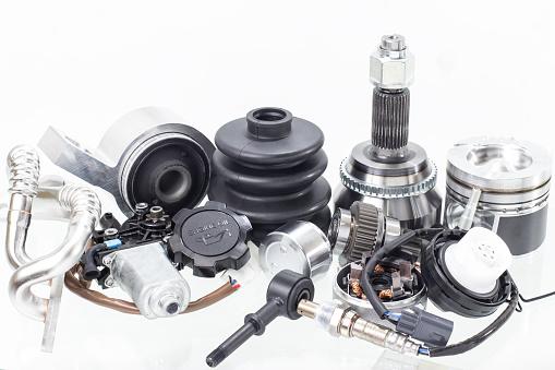 automobile engine parts isolated on white background. Auto shop 1055698780