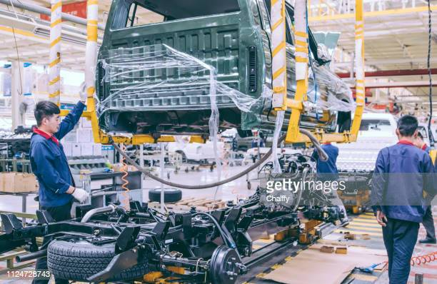 automobile factory welding assemble line - making stock pictures, royalty-free photos & images