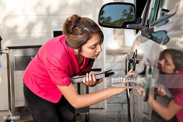 automobile insurance adjuster inspecting damage to vehicle - health insurance stock pictures, royalty-free photos & images