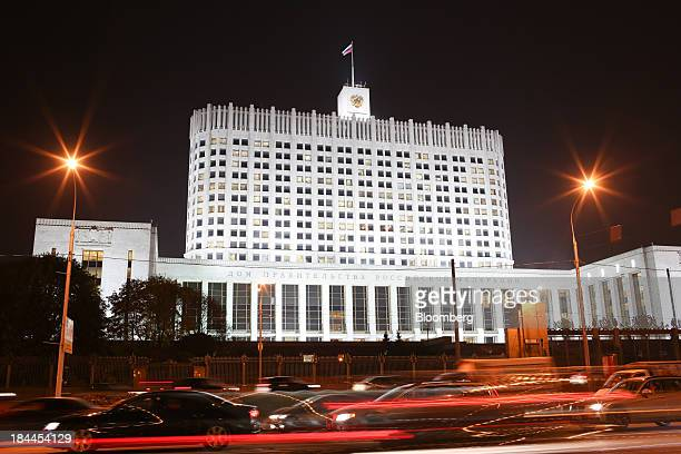 Automobile light trails pass the Russian White House government building in Moscow Russia on Thursday Oct 10 2013 Tinkoff Credit Systems Bank...