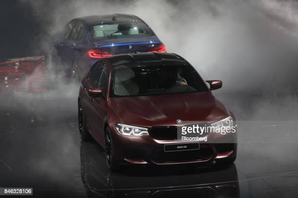 M5 automobile manufactured by Bayerische Motoren Werke AG drives on stage during the second media preview day of the IAA Frankfurt Motor Show in...