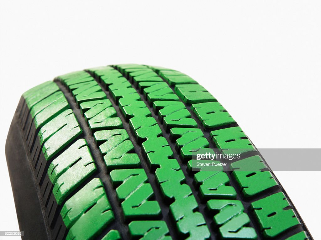 Automobile tire with green treads : Stock Photo
