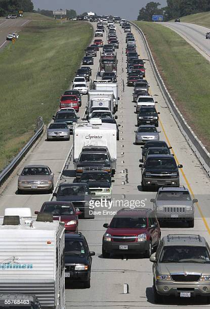 Automobile traffic is backed up on Interstate 45 north of Houston September 25 2005 in Willis Texas A barge slipped it's mooring and floated into the...