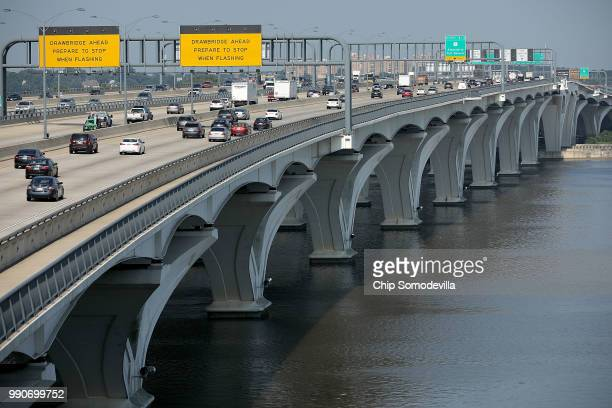 Automobile traffic moves across the Woodrow Wilson Bridge along the Capitol Beltway during rush hour one day before the 4th of July holiday July 3,...