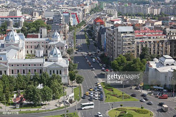Automobile traffic moves along the road towards the University roundabout in the center of Bucharest Romania on Wednesday July 2 2014 Romania's...