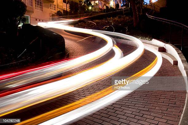 automobile trails on lombard street, san francisco - lombard street san francisco stock pictures, royalty-free photos & images