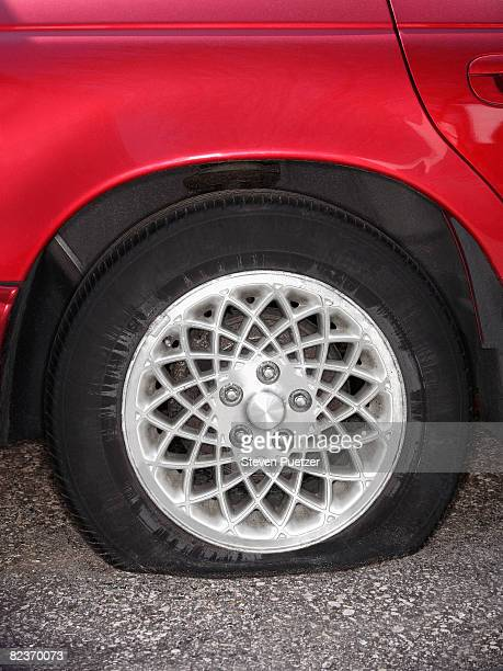 Automobile with flat tire
