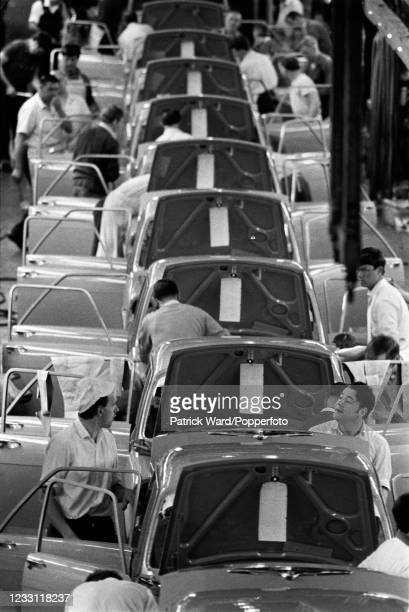 Automobile workers on the production line at British Leyland car factory at Longbridge, West Midlands, circa June 1969. From a series of images to...