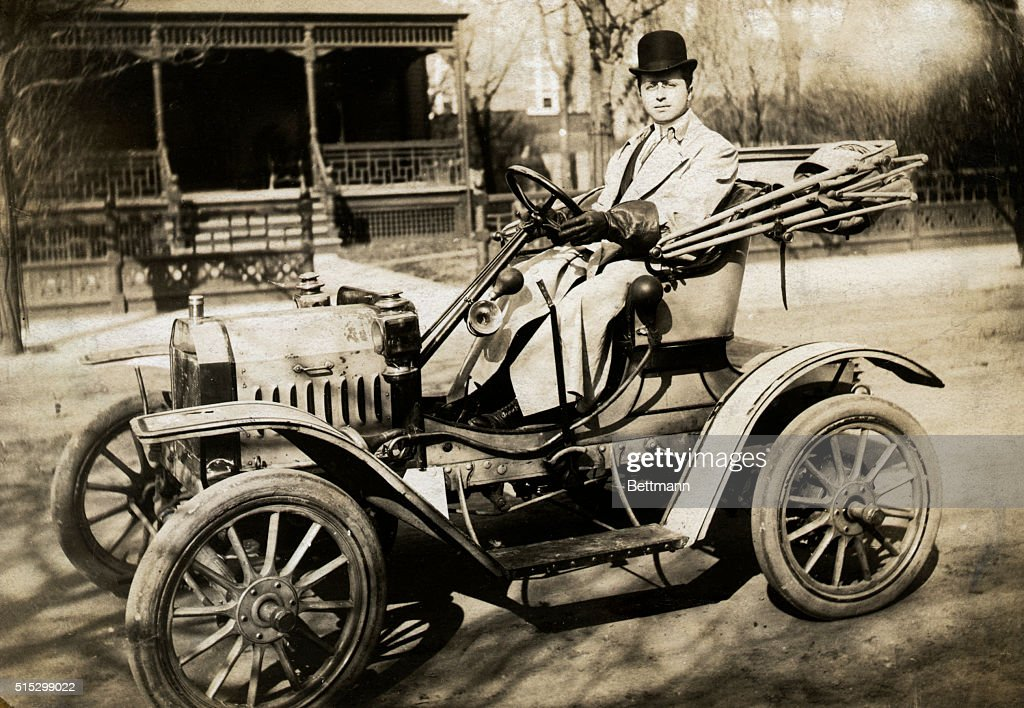 Man Driving One-Cylinder Brush Automobile : News Photo