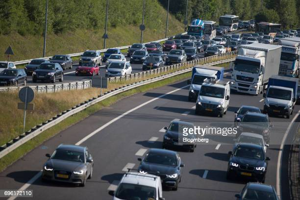 Automobiles and trucks travel as morning rush hour traffic heads to Luxembourg city in Luxembourg, on Wednesday, June 14, 2017. While many find the...