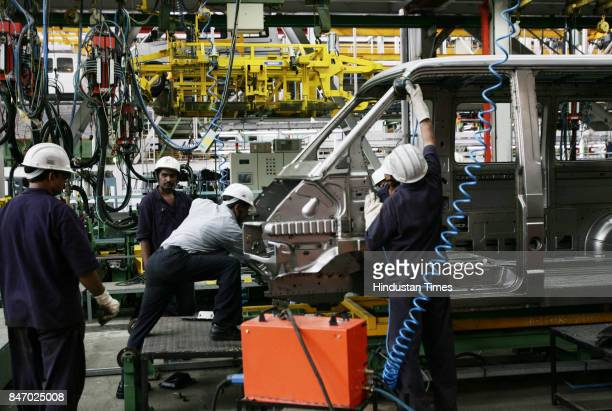 Automobiles Cars Car Factory Workers at the assembling plant of the new range Vehicle The Winger at Tata Motors plant in Pimpri