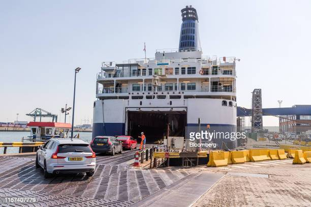 Automobiles drive onboard a PO Ferries Ltd crosschannel ferry before sailing to the UK from the Port of Zeebrugge in Zeebrugge Belgium on Tuesday...