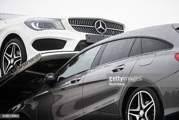 Automobiles from the Mercedes CLA-class sit on a transporter truck ready for delivery outside the Mercedes-Benz AG automobile plant, operated by...