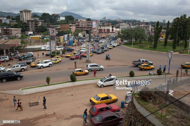 Automobiles make their way around Nlongkak roundabout during early morning in Yaounde, Cameroon, on Monday, June 4, 2018. Cameroon adjusted its 2018...