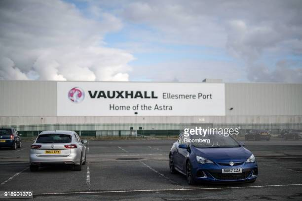 Automobiles manufactured by Vauxhall Motors Ltd owned by PSA Group sit in the factory parking lot in Ellesmere Port UK on Monday Feb 5 2018 Being...