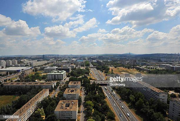 Automobiles pass along the E75 highway as the city skyline stretches out beyond Belgrade Serbia on Monday Oct 21 2013 Serbia's government revealed a...