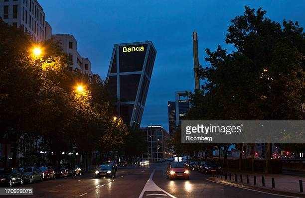 Automobiles pass one of the Kio towers headquarters of Bankia SA in Madrid Spain on Wednesday June 19 2013 Bailing out Bankia SA SpainÃs...