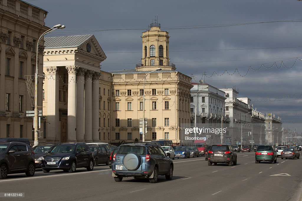 Automobiles pass the headquarters of the State Security Committee of Belarus, left, in Minsk, Belarus, on Wednesday, March 16, 2016. European Union governments scrapped sanctions on leaders of Belarus in an effort to pry the former Soviet republic out of the shadow of the Kremlin. Photographer: Andrey Rudakov/Bloomberg via Getty Images