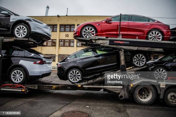 Automobiles produced by Tesla Inc sit a car transporter truck after arriving on the Glovis Courage vehicles carrier vessel at the Port of Oslo in...