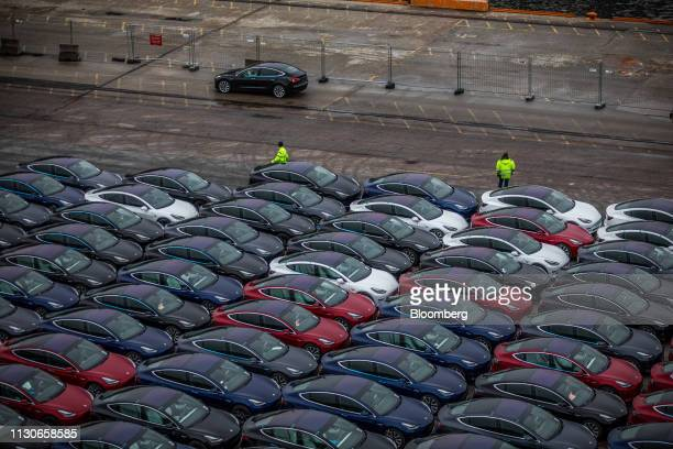 Automobiles produced by Tesla Inc sit dockside after arriving on the Glovis Couragevehicles carrier vessel at the Port of Oslo in Oslo Norway on...