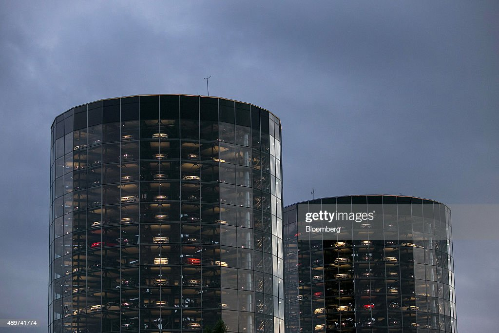 Automobiles, produced by Volkswagen AG (VW), sit behind windows inside the auto delivery towers at the VW headquarters in Wolfsburg, Germany, on Wednesday, Sept. 23, 2015. Volkswagen's escalating scandal over emissions-test cheating is beginning to ripple across the $10 trillion global corporate bond market. Photographer: Krisztian Bocsi/Bloomberg via Getty Images