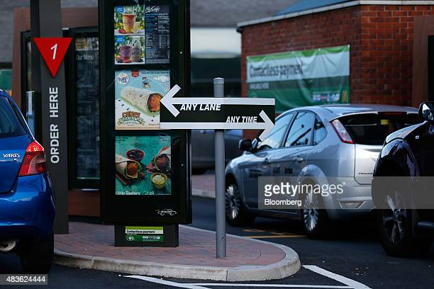 Automobiles queue at the drivethru food ordering area of a McDonald's Corp restaurant in Manchester UK on Monday Aug 10 2015 McDonald's Chief...