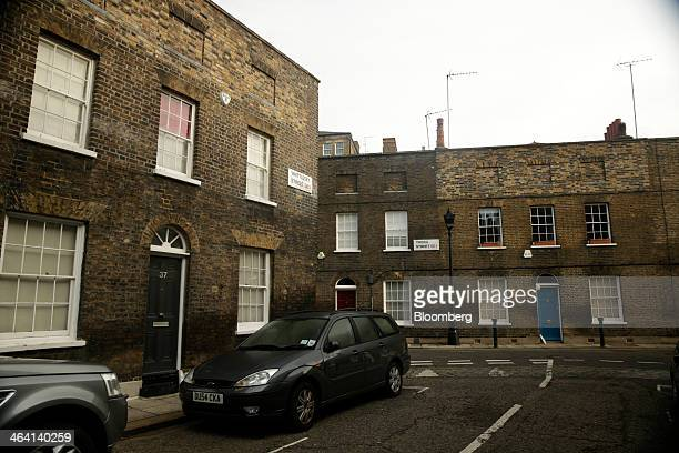 Automobiles sit parked in front of rows of residential terraced properties in the Waterloo district of London UK on Monday Jan 20 2014 London...