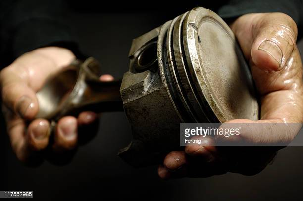 automotive mechanic holding piston - piston stock pictures, royalty-free photos & images