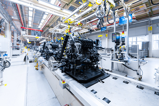Automotive mechanical assembly, engine, transmission, suspension and breaking system. Automotive engine assembly line is in production. Car Assembly by parts 1086130530
