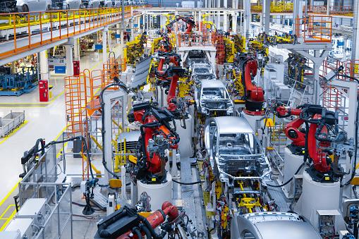 Automotive production line. Welding car body. Modern car Assembly plant 1069360792