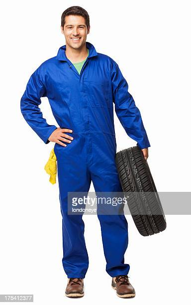 automotive technician holding a spare tyre - isolated - mechanic stock pictures, royalty-free photos & images