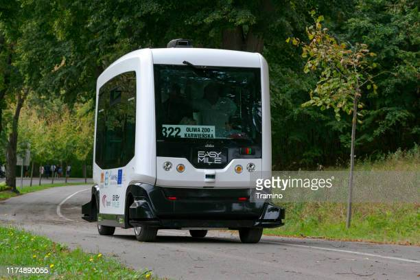 autonomous bus in motion - driverless car stock pictures, royalty-free photos & images