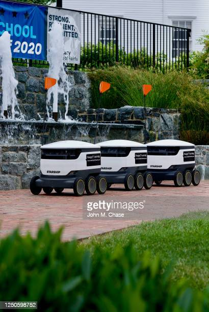 autonomous food delivery robots - alternative fuel vehicle stock pictures, royalty-free photos & images