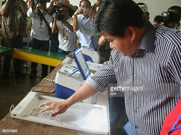 Autonomous Region of Muslim Mindanao Governor Puti Ampatuan running for reelection casts his votes using the new computerized machine at Shariff...
