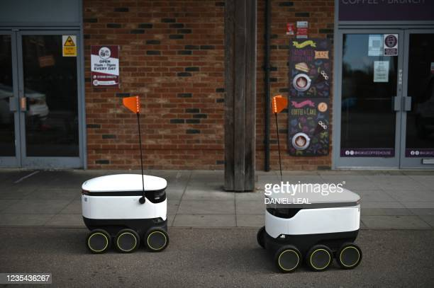 Autonomous robots called Starship are pictured on their way to deliver groceries from a nearby Co-op supermarket in Milton Keynes, England on...