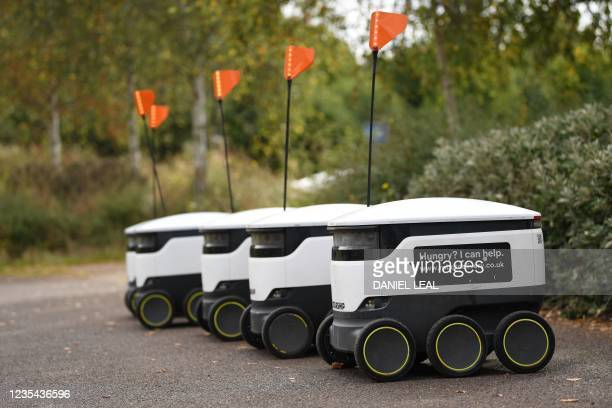 Autonomous robots called Starship which deliver groceries are parked outside a local Co-op supermarket in Milton Keynes, England on September 20,...