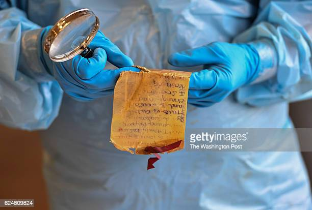 Autopsy tech Matt Arredondo inspects a love letter that was found on a deceased illegal border crosser who's remains were sent to the Webb County...