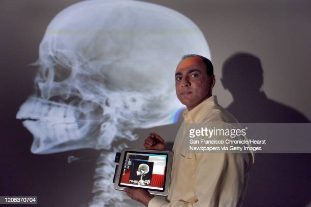 AUTOPSY_173_fljpg Afshad Mistri of Silicon Graphics Inc explains the computing technology for vitual autopies which has attracted attention from...
