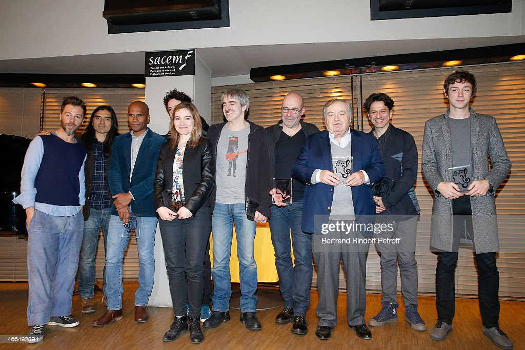 Autor, Composer and Singer Christophe Mae, Autor Michael Seilhan-Ibrahim and Composer Felipe Saldivia, winners of the 'Song Award' for the song 'Tombe sous le Charme', Autor Composer and Singer Liz Van Deuq, winner of the 'Autoproduction award' for Album 'Anna-Liz', Composer Jean-Jacques Daran and Autor Pierre-Yves Lebert, winners of the 'Song Award' for the song 'Les gens du Voyage', Composer Jean-Pierre Bourtayre, winner od a 'Carreer award' and Autor Francois Welgryn and Composer Renaud Rebillaud, winners of the 'Song Award' for the song 'Color Gitano pose during the 'Grands Prix de L'UNAC 2015' - Award Ceremony at Sacem on March 16, 2015 in Paris, France.