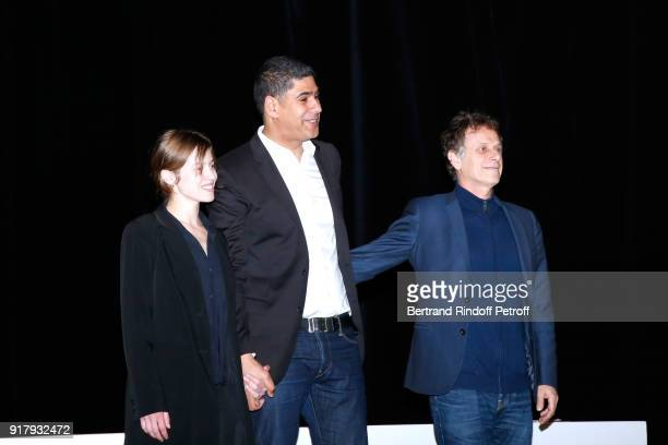 Autor of the Piece Rachid Benzine standing between actors of the Piece Lou de Laage and Charles Berling acknowledge the applause of the audience at...