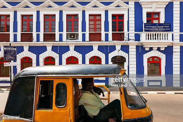 Autorickshaw by a colorful Goan building in Panaji Goa India