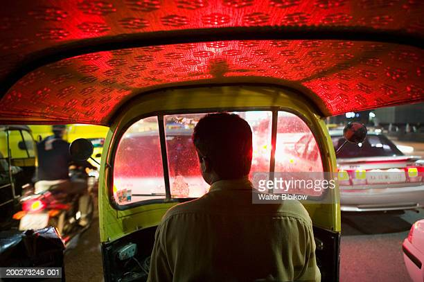 autorickshaw taxi driving in evening traffic, rear view - bangalore stock pictures, royalty-free photos & images