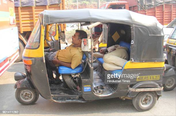 Autorikshaw drivers take a nap as Traffic jammed for more than 5 hours due to Rasta Roko by Dalit protesters during Maharashtra Bandh at Western...