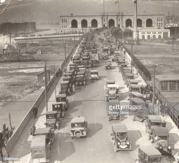 Autos at the Commonwealth Pier waiting for registration plates