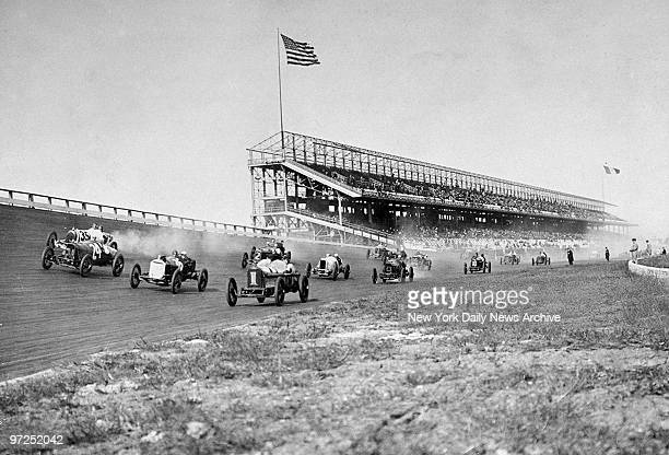 Autos raise the dust at Sheepshead Bay Race Track during a ban on horse racng imposed by Gov Charles Evans Hughes