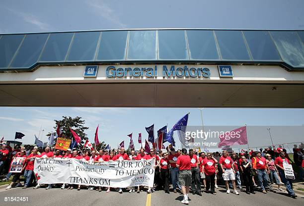 Autoworkers and their supporters rally outside of GM's Oshawa assembly facilities on June 12 2008 in Oshawa Canada Demonstrators were protesting...