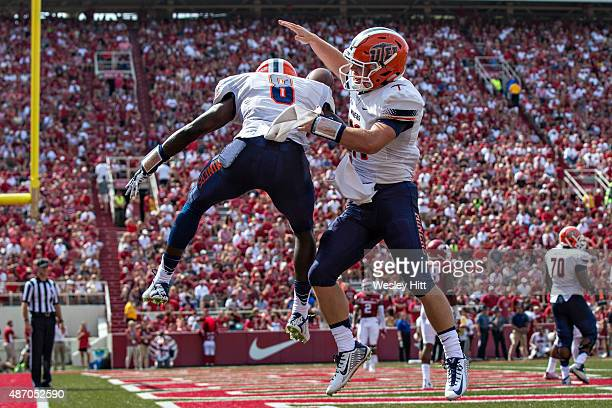 Autrey Golden and Mack Leftwich of the UTEP Miners celebrate after a touchdown against the Arkansas Razorbacks at Razorback Stadium on September 5...
