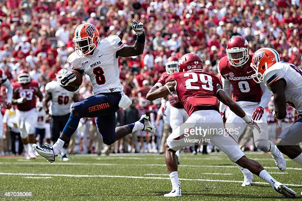 Autrey Golden of the UTEP Miners runs the ball in for a touchdown during a game against the Arkansas Razorbacks at Donald W Reynolds Razorback...