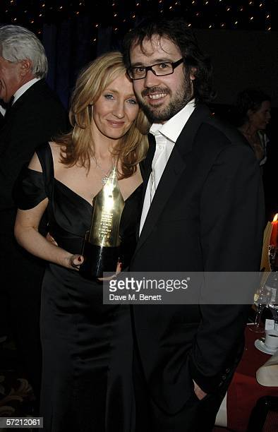 Autrhor JK Rowling and husband Neil Murray pose with her Book of the Year award for Harry Potter and the HalfBlood Prince at the British Book Awards...