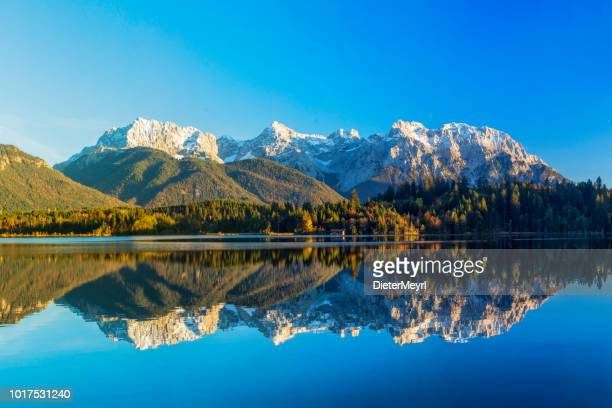 autumn at alpine lake schmalensee- view to mount karwendel, garmisch partenkirchen, alps - mittenwald stock pictures, royalty-free photos & images